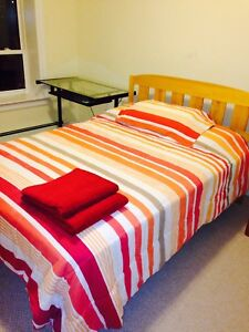 Solid wooden double bed from a clean home.