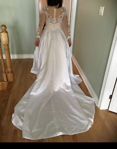 Satin and lace wedding gown w/long train, pearls and sequence.