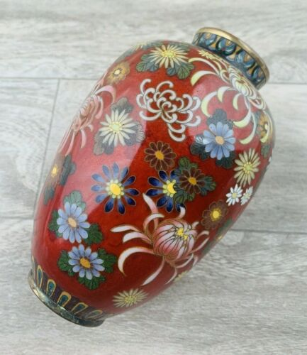 An Antique Japanese Cloisonne Floral Red Ground Decorated Vase