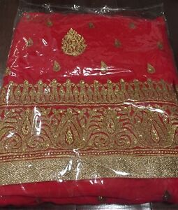 Red unstitched saree with heavy work