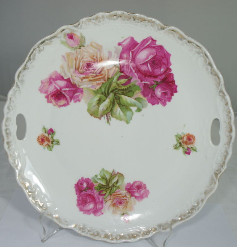 ANTIQUE PORCELAIN CAKE PLATE FLOWERS PINK ROSES CUT OUT HANDLES EMBOSSED RIMS