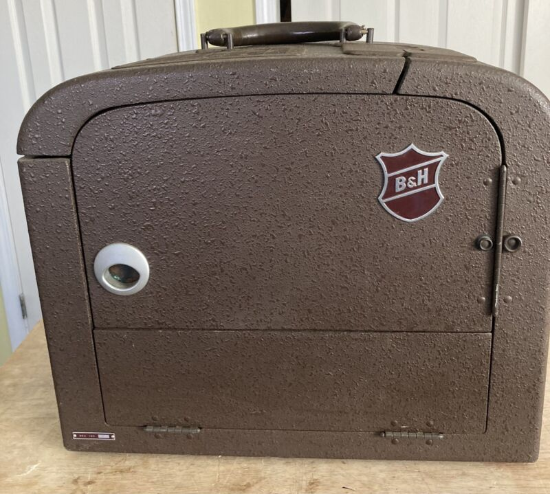 Vintage Bell and Howell B & H Filmosound 185 16MM Film Projector. See pics