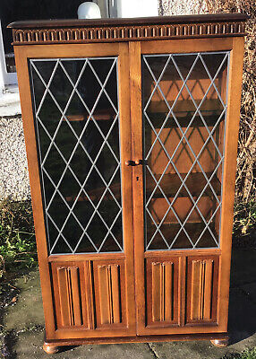 20th C Oak Cabinet/bookcase With Leaded Glazed Doors On Bun Feet.