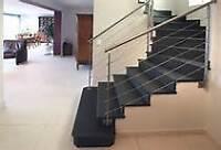 Une photo vault milles mots, installation de tapis pour escalier