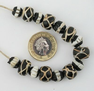 African trade bead strand. Venetian 'dog tooth' and 'snake' glass trade beads