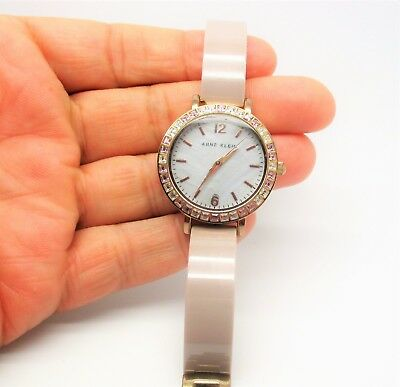 Anne Klein Women's AK/1442RGTP Swarovski Crystal-Accented Bangle Watch