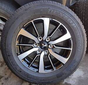 5x 265x60 r18 Dunlop AT20's with Pajero Sport Rims only 4000kms Coopers Plains Brisbane South West Preview