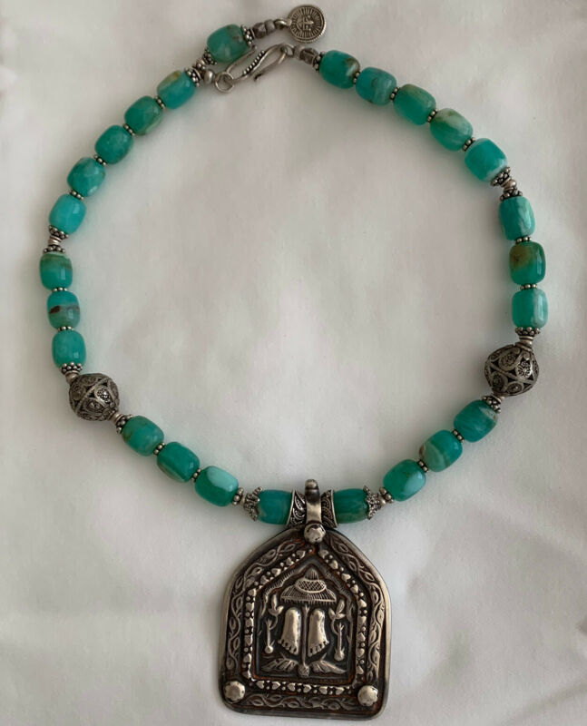 RARE PERUVIAN OPAL AND ANTIQUE SILVER BUDDHA FEET AMULET NECKLACE.