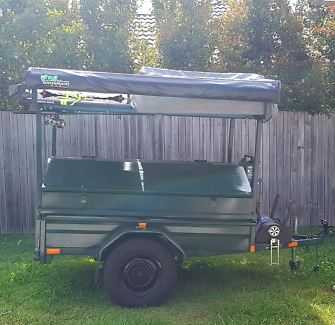 Camping trailer and roof top tent