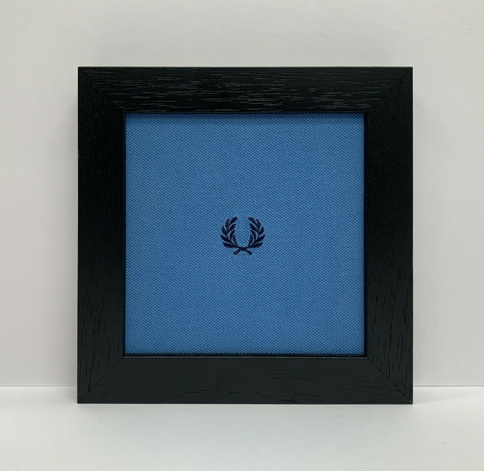 Fred Perry Art Framed Blue Polo Shirt Logo with a Black Grain Frame