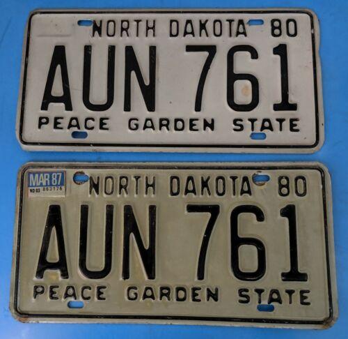 North Dakota License Plate 1980 Pair Peace Garden AUN-761