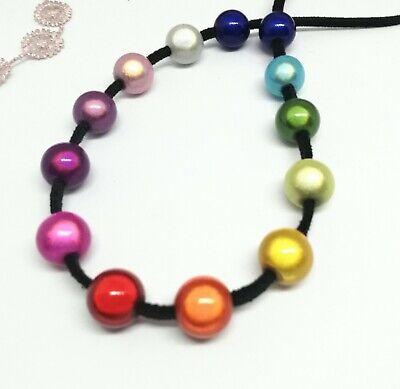 Halskette bunt Regenbogen Band schwarz Perlen  leuchtend blau rot gelb grün 3D ()
