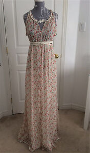 New- Flowery summer dress - size Xs and can fit M