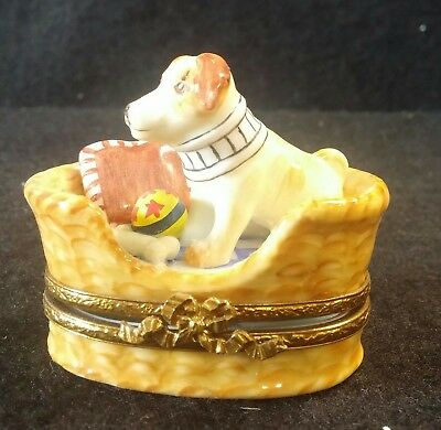 FRANCE LIMOGES BOX DOG IN WICKER BED WITH YELLOW/RED BALL AND BONE *NEW*