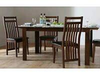 Solid dark oak table with six chairs.