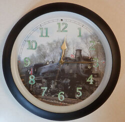 Train locomotive wall clock with a different train sound played on the hour