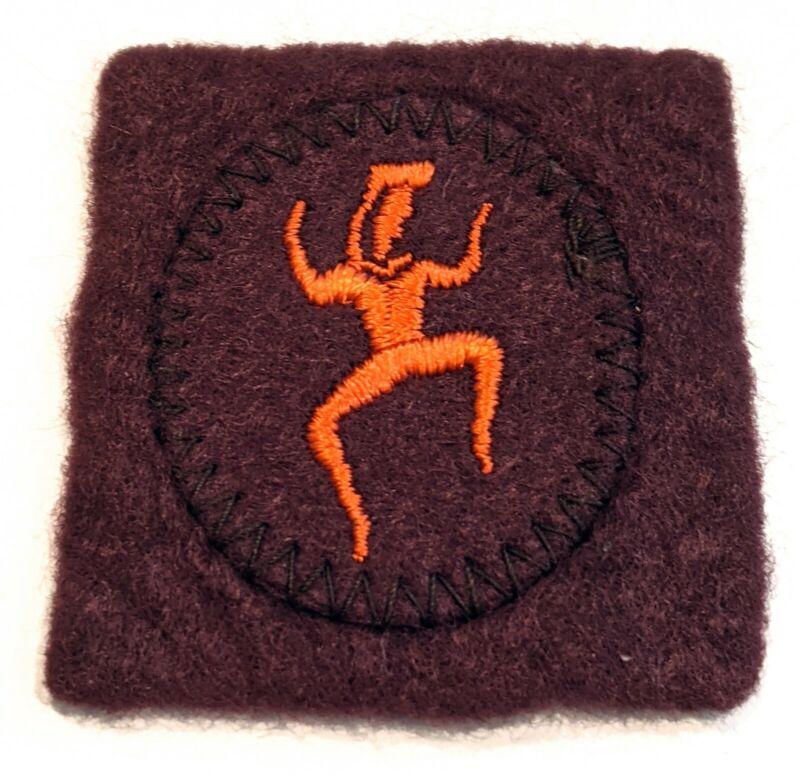 Dancing Orange Brownie Emblem from front of Brownie Beanie Felt Hat