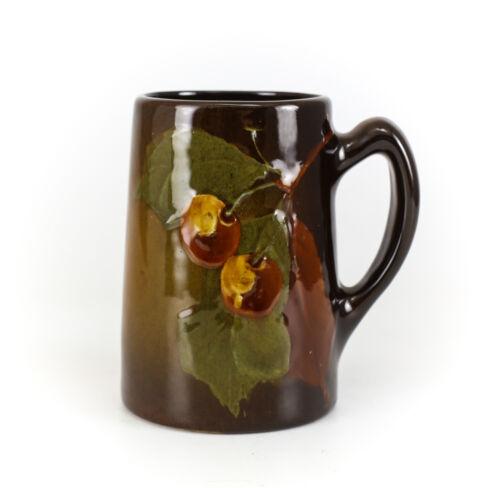 Owens Utopian Pottery Mug # 1035, c1900 Deep brown glaze, cherries and leaves