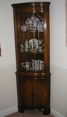 Floorstanding triangular mahogany display cabinet excellent condition