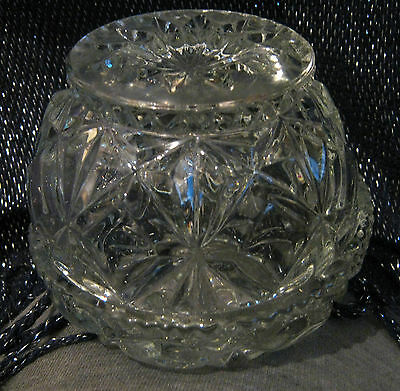 Glass two part item for holding fruit/lemon perhaps as base has a spike