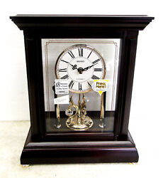 SEIKO MANTEL CLOCK IN WOODEN CASE WITH  3 ROTATING SWAROVSKI CRYSTALS QXW229BLH