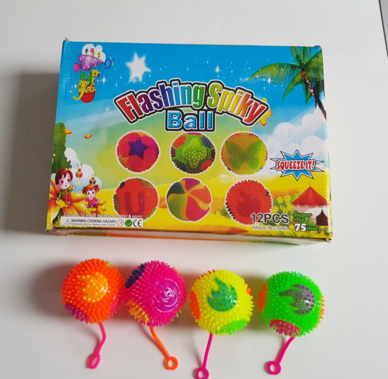 A+box+of+12+squeaky+bouncing+flashing+spiky+balls+in++4+colours+and+rope+string.