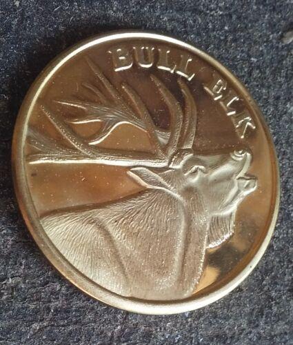 Bull Elk bright brass card guard coin
