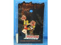 HOOTERS CHEERLEADER BROWN HAIR GIRL WITH 3D ORANGE POM POMS  FOOTBALL LAPEL PIN