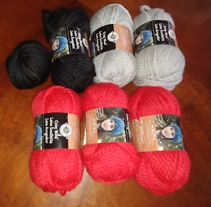 7 skeins Cozy Wool yarn. Red, Black and Gray...