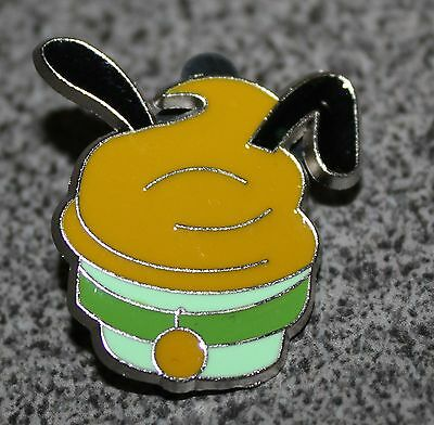 DISNEY PIN PLUTO CUPCAKE GREEN WRAPPER WITH COLLAR GOLD ICING