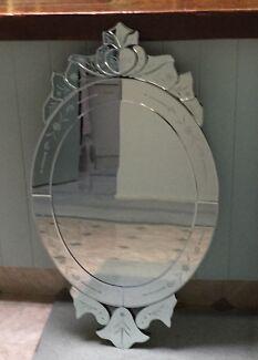 Large ornate bevilled mirror
