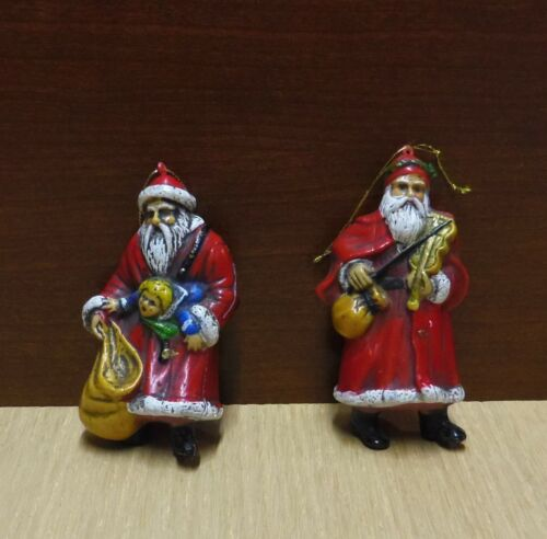 2 RETRO PLASTIC SANTA'S, ONE WITH A VIOLIN & ONE WITH A DOLL