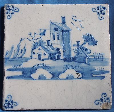 Blue and white antique Delft tile with a house