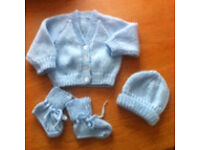 Hand knitted baby outfit