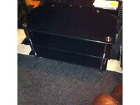 Glass shelved TV unit