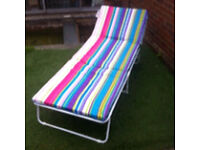 Adjustable folding sun lounger