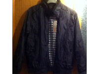 Brand new mens coat, never been worn. Still with tag on. Selling due to being too small. Size Medium