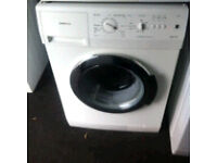 SIEMENS WASHING MACHINE COMES WITH A STORE WARRANTY GOOD CONDITION