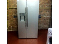 AMERICAN style fridge freezer ice & water dispenser comes with a store warranty