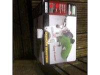 Electric chainsaw sharpener boxed