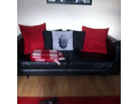 2 Two Black Faux Leather Sofas