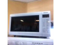PANASONIC NEW WHITE MICROWAVE OVEN COMES WITH A FULLY WORKING STORE WARRANTY