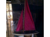 A vintage wooden pond yacht