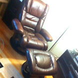 Beautiful leather chair with foot rest.