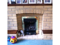 Gas fire with brick surround and wooden mantelpiece