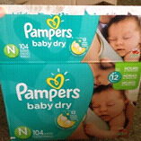 3/4 of a box left- size NB Pampers baby dry diapers