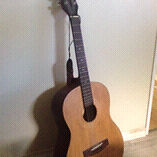 Short necked acoustic guitar