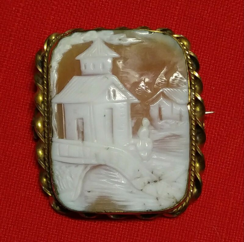 ANTIQUE CARVED SHELL CAMEO BROOCH, WITH WOMAN WALKING ON BRIDGE, WITH BUILDINGS