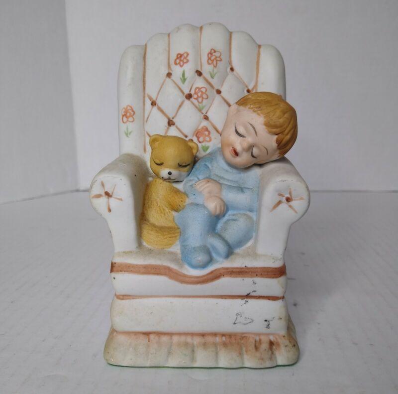 Ceramic Blonde Boy & Brown Teddy Bear Sleeping In Chair. Blue Pajamas Figurine