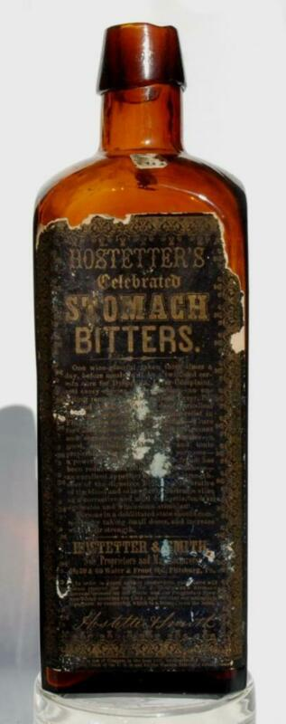 """HOSTETTER STOMACH BITTERS AMBER BOTTLE WITH LABELS """"W MCC&C 4"""" ON BASE"""